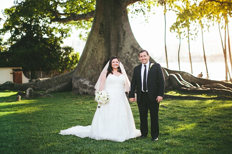Bride and Groom in front of giant tree Flagler Museum Palm Beach
