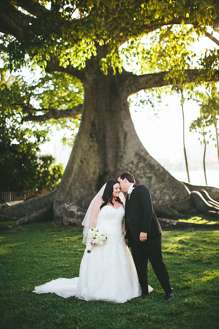 Wedding held by giant tree at Royal Poinciana Chapel Palm Beach