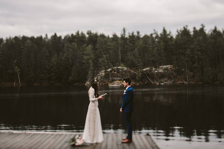 Couple exchanging vows on a dock in Muskoka